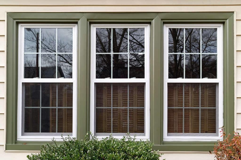 Three windows with green trim
