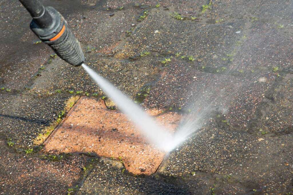 Patio being power washed